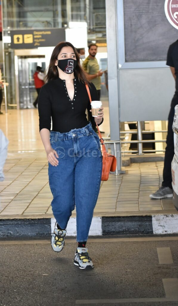 Tamannaah in a black top and mom jeans at RGI