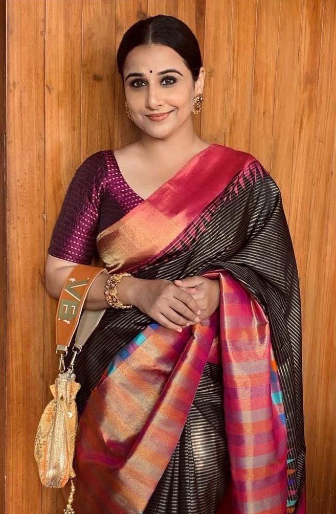 Vidya Balan in a black muhurth saree for a wedding1