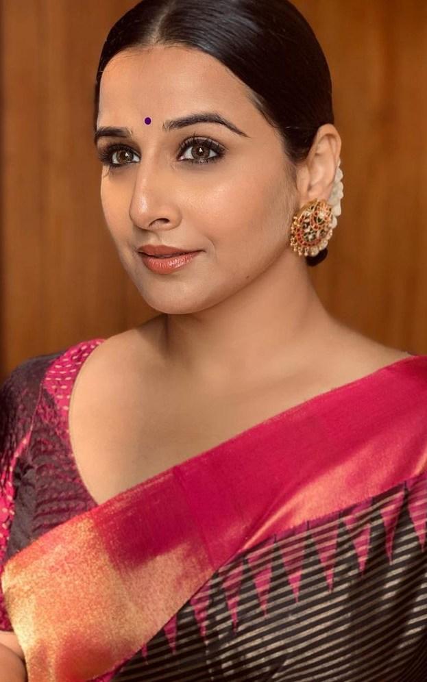 Vidya Balan in a black muhurth saree for a wedding2