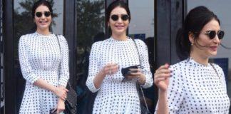 karishma tanna in a white polka dot midi dress