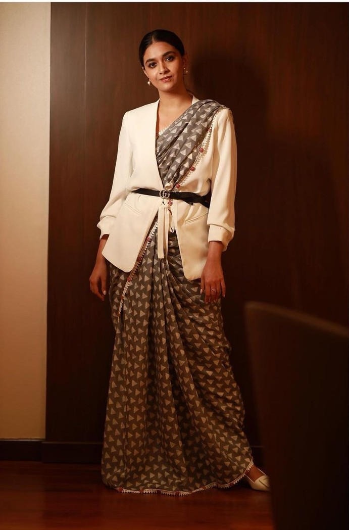 keerthy suresh in a grey saree with white jacket and belt