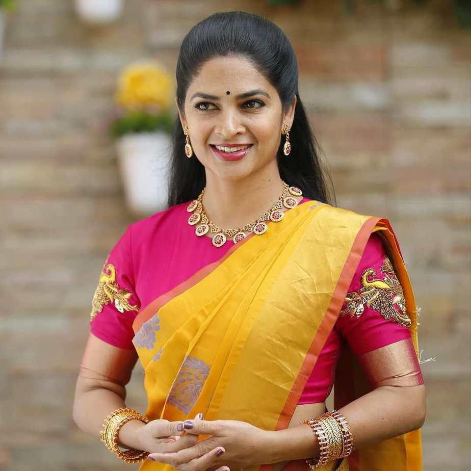 madhumita siva balaji yellow saree with pink blouse