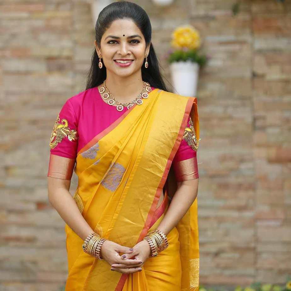 madhumita siva balaji yellow silk saree and pink blouse