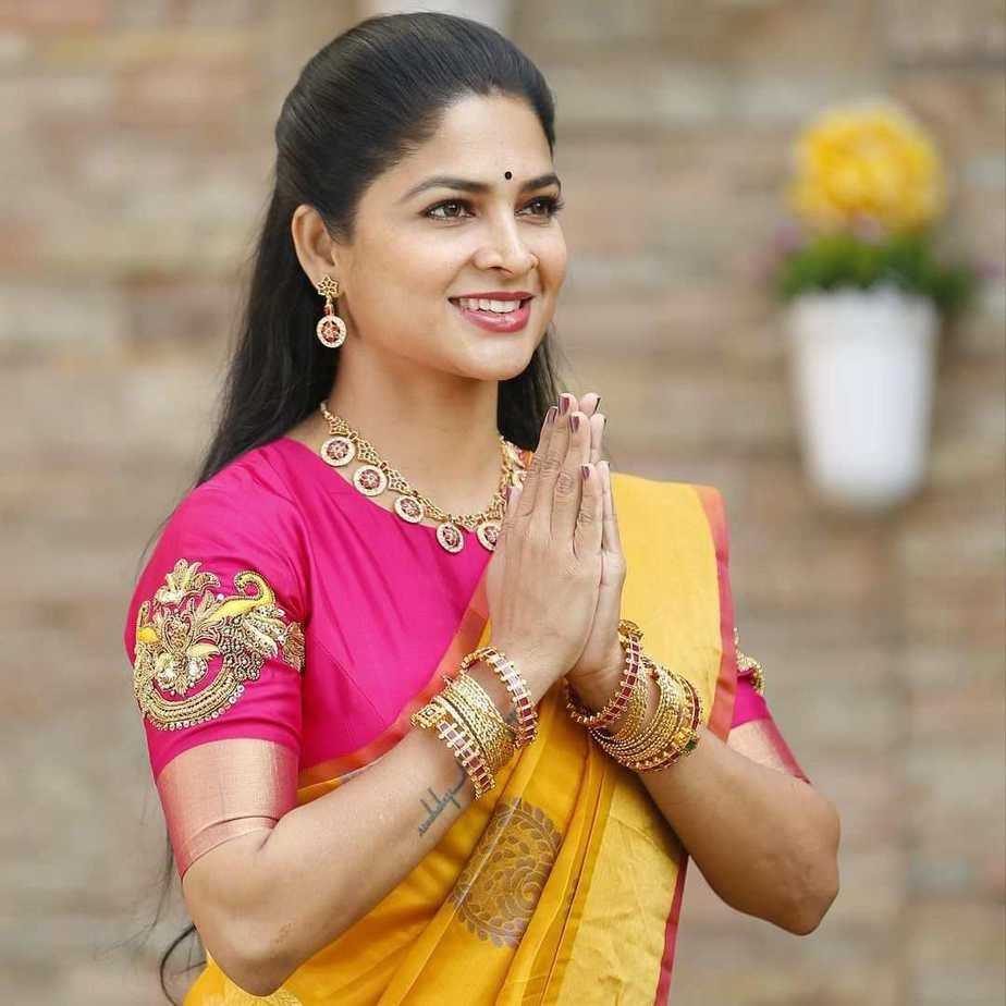 madhumita sivabalaji pink brocade blouse with yellow saree