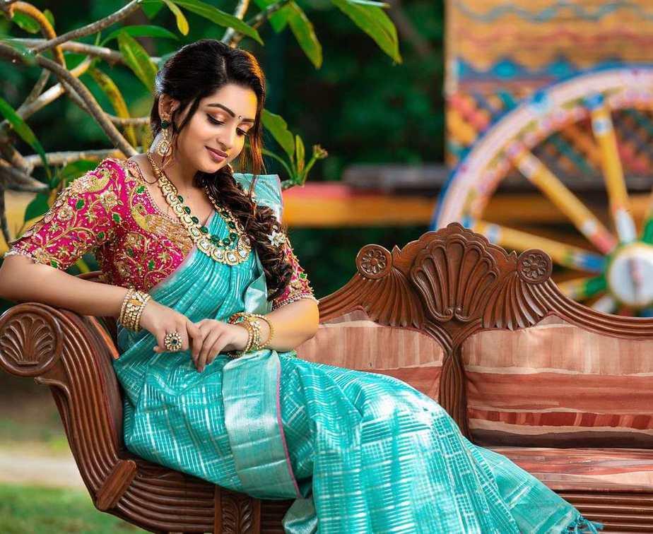 nakshatra nagesh blue silk saree and heavy work pink blouse