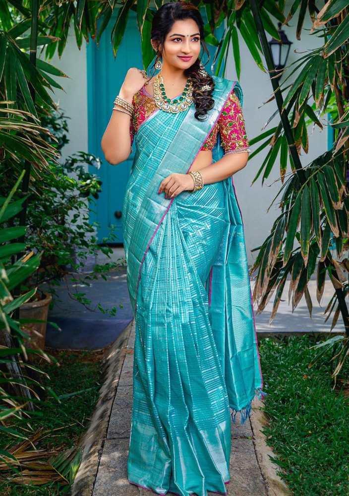 nakshatra nagesh blue silk saree and pink designer blouse
