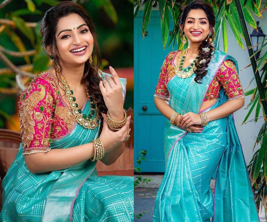 nakshatra nagesh in a blue silk saree and pink blouse