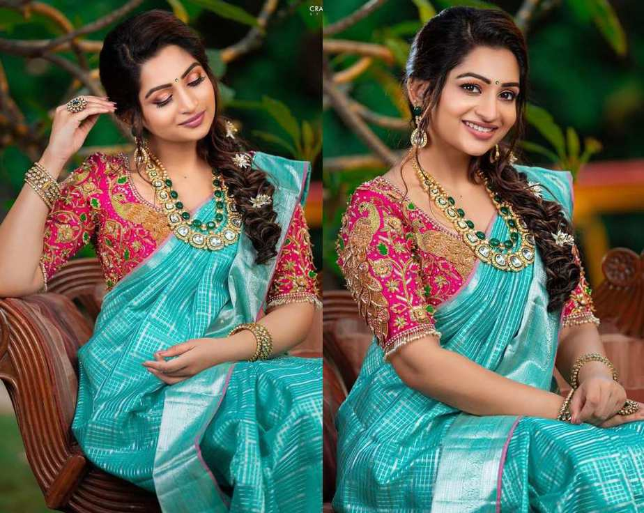 nakshatra nagesh in a blue silk saree with pink blouse