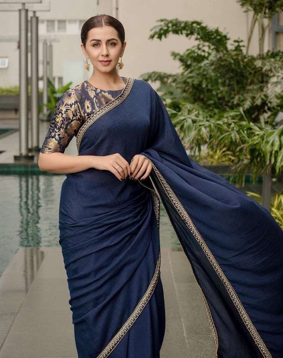 nikki galrani in a navy blue georgette saree with brocade blouse