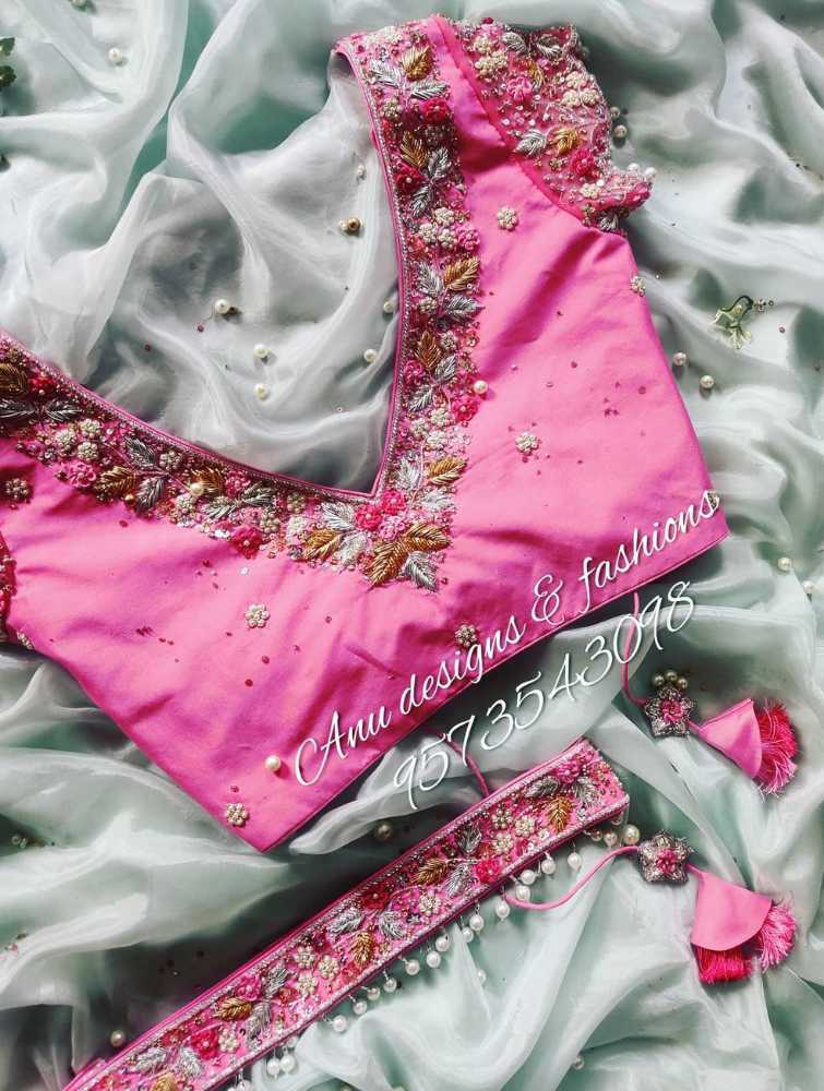pink maggam work designer blouse with floral embroidery designs and belt