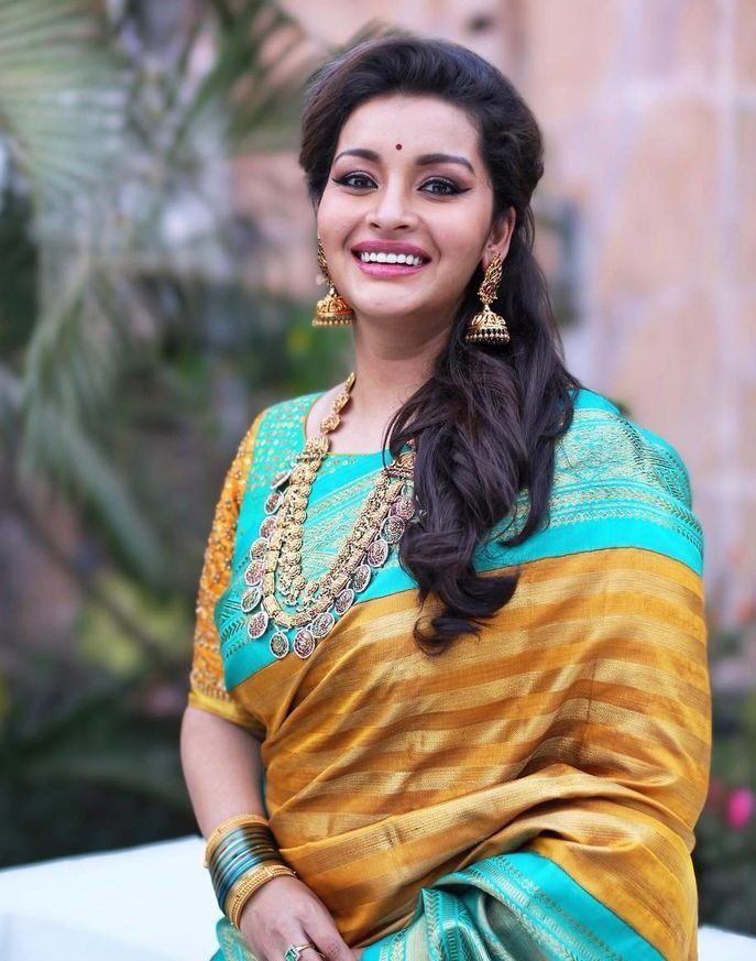 renu desai in bhargavi kunam orange kanjeevaram saree