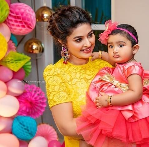 sneha prasanna with daughter Aadyanthaa at 1st birthday