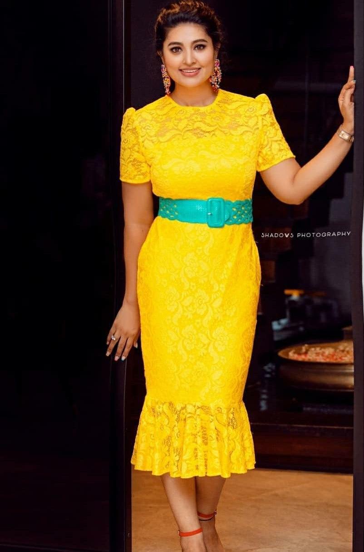 snehaa prasanna yellow bodycon dress at daughter Aadyanthaa birthday