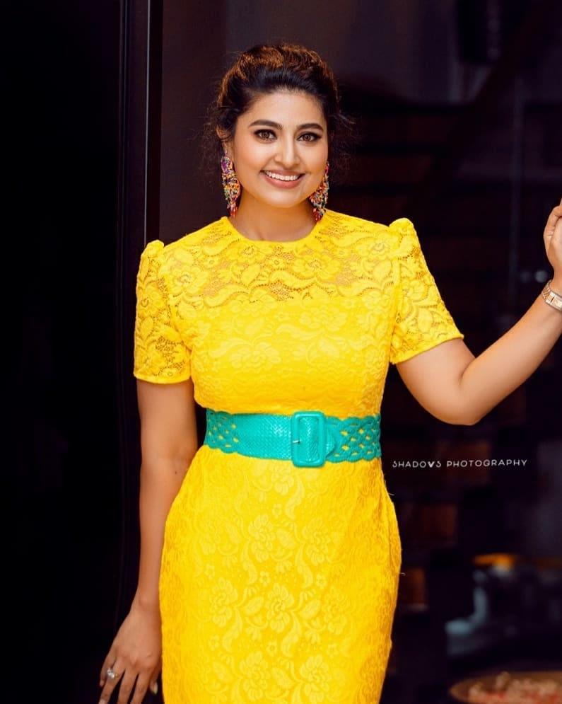 snehaa prasanna yellow dress at daughter Aadyanthaa birthday