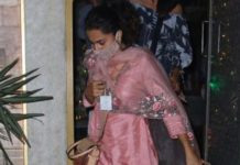 An all-pink suit can never fail to leave us in awe. Recently, we had witnessed a rising usage of pink in celebs for creating western and ethnic outfits. Pink has become a go-to color for recreating looks for different events. Scroll down to have a closer look at the pink suit of Taapsee Pannu. Taapsee Pannu was spotted in Juhu, opting for a shimmering pink three-piece suit from the label La Glitz by Chhavi. The suit had floral embroidery near the neckline and was teamed up with an organza dupatta. The entire fabric was plain except for work done on the neckline and dupatta borders. She upped her look by choosing golden glittered Punjabi Juttis. There's more. She also carried a beige-brown crossbody sling bag to give a glam finish to her ethnic look. Lastly, she wore a light-brown colored mask and tied her heavy curly hair in a high ponytail.