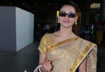 urvashi rautela in a checkered brown saree at airport