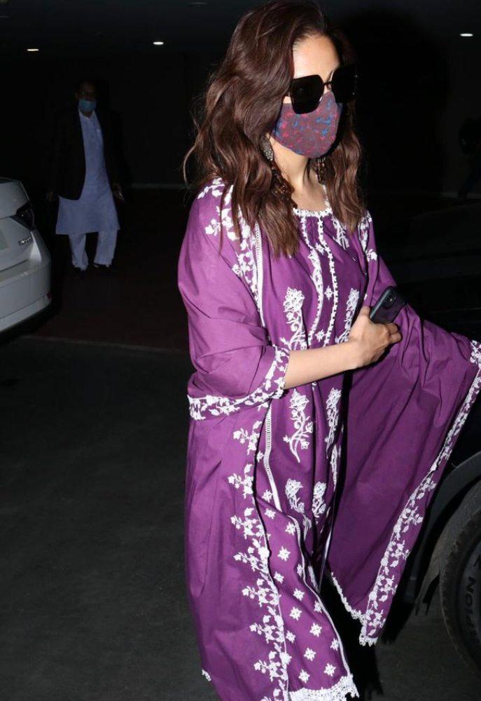 yami gautam in wine suit set at airport