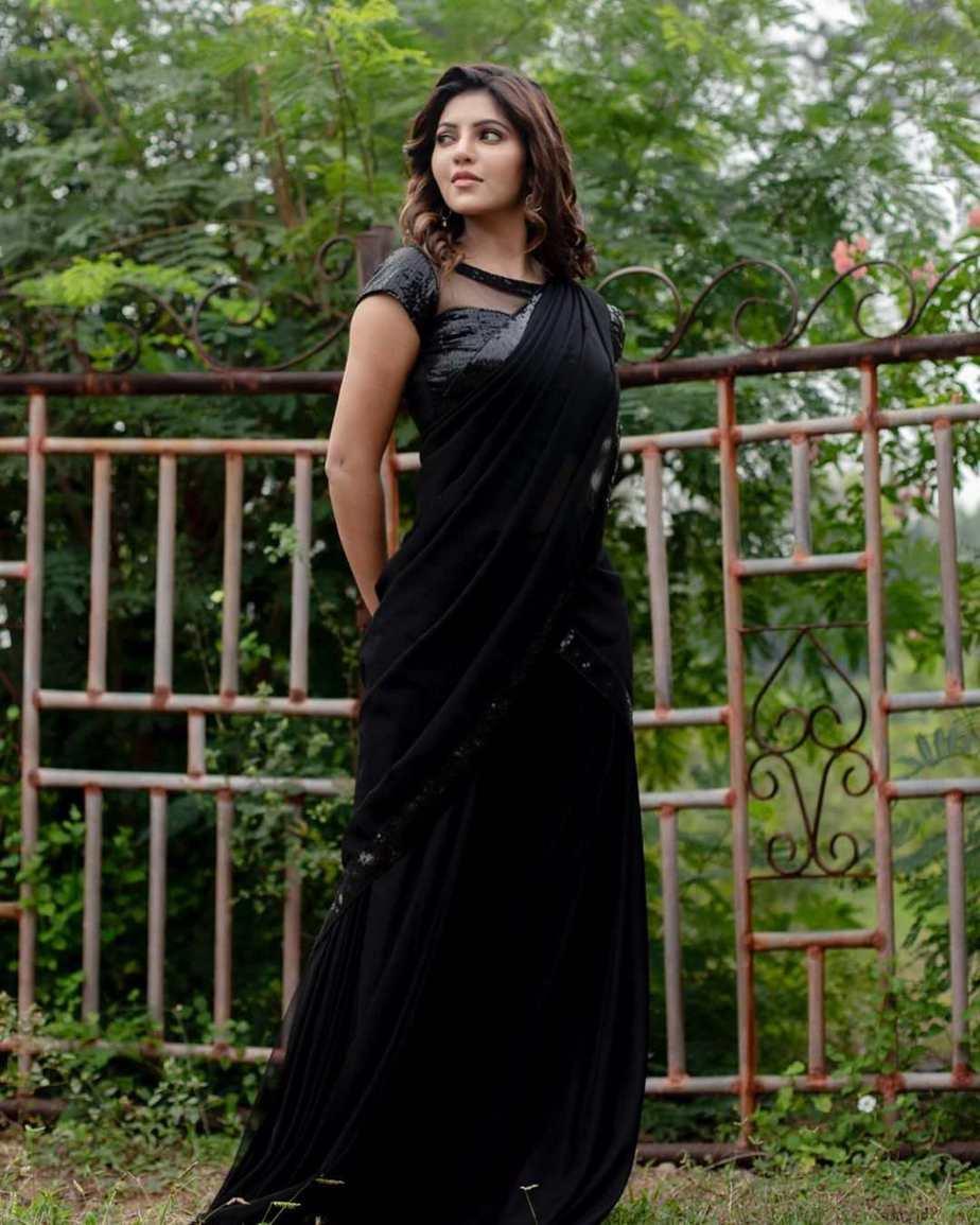Athulya Ravi in a black half saree by abarna sundaram