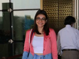 Kajal aggarwal in blue denim-multi colored jacket at Hyderabad airport1