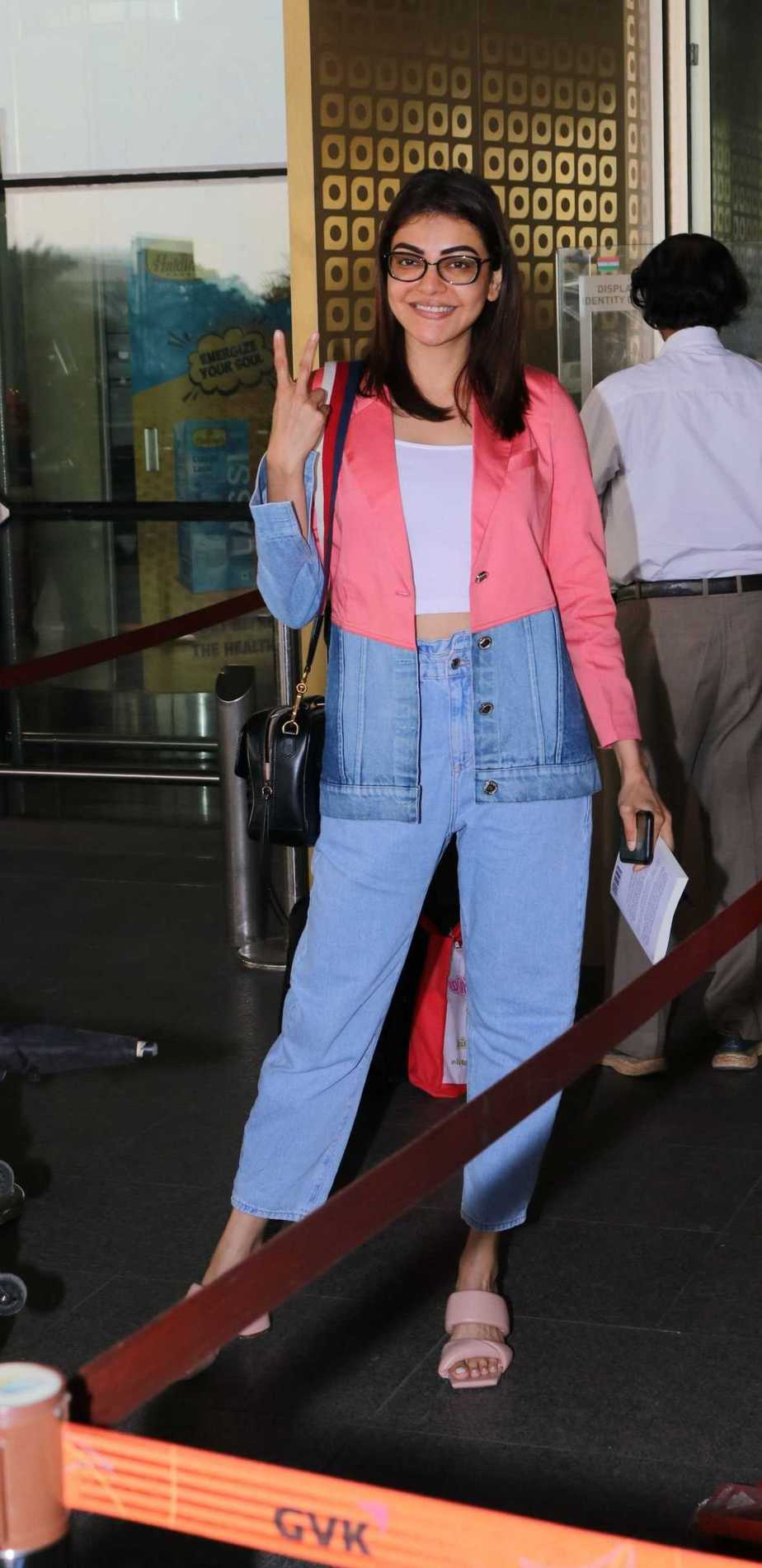 Kajal aggarwal in blue denim-multi colored jacket at Hyderabad airport3