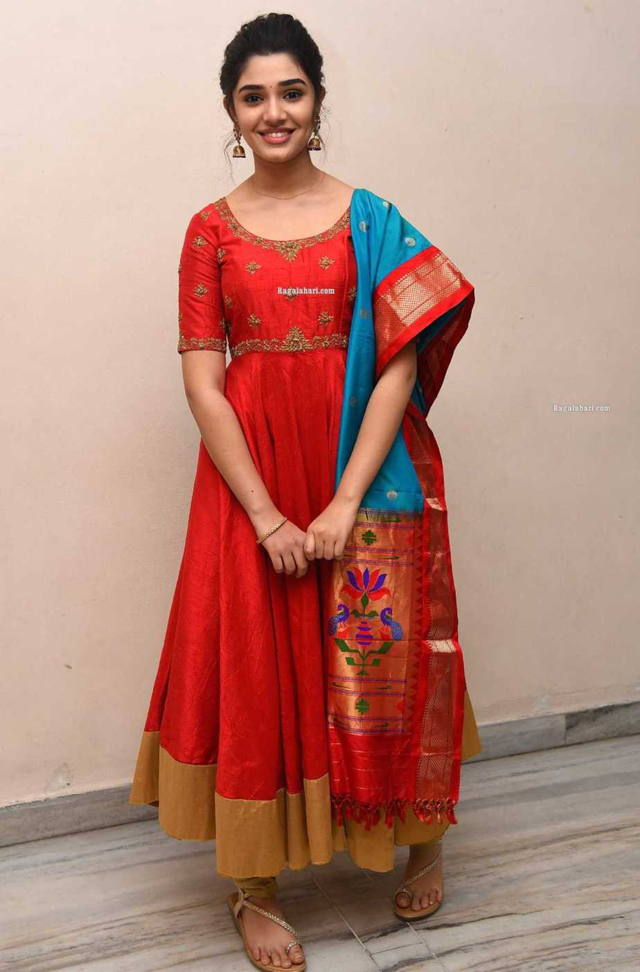 Krithi Shetty in a red anarkali set for uppena success meet3.1