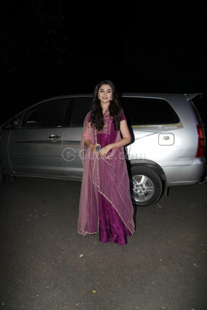Krithi Shetty in purple outfit at director Sukumar's family function (1)