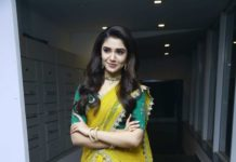 Krithi shetty in a yellow half saree with green blouse for uppena pre-release event3
