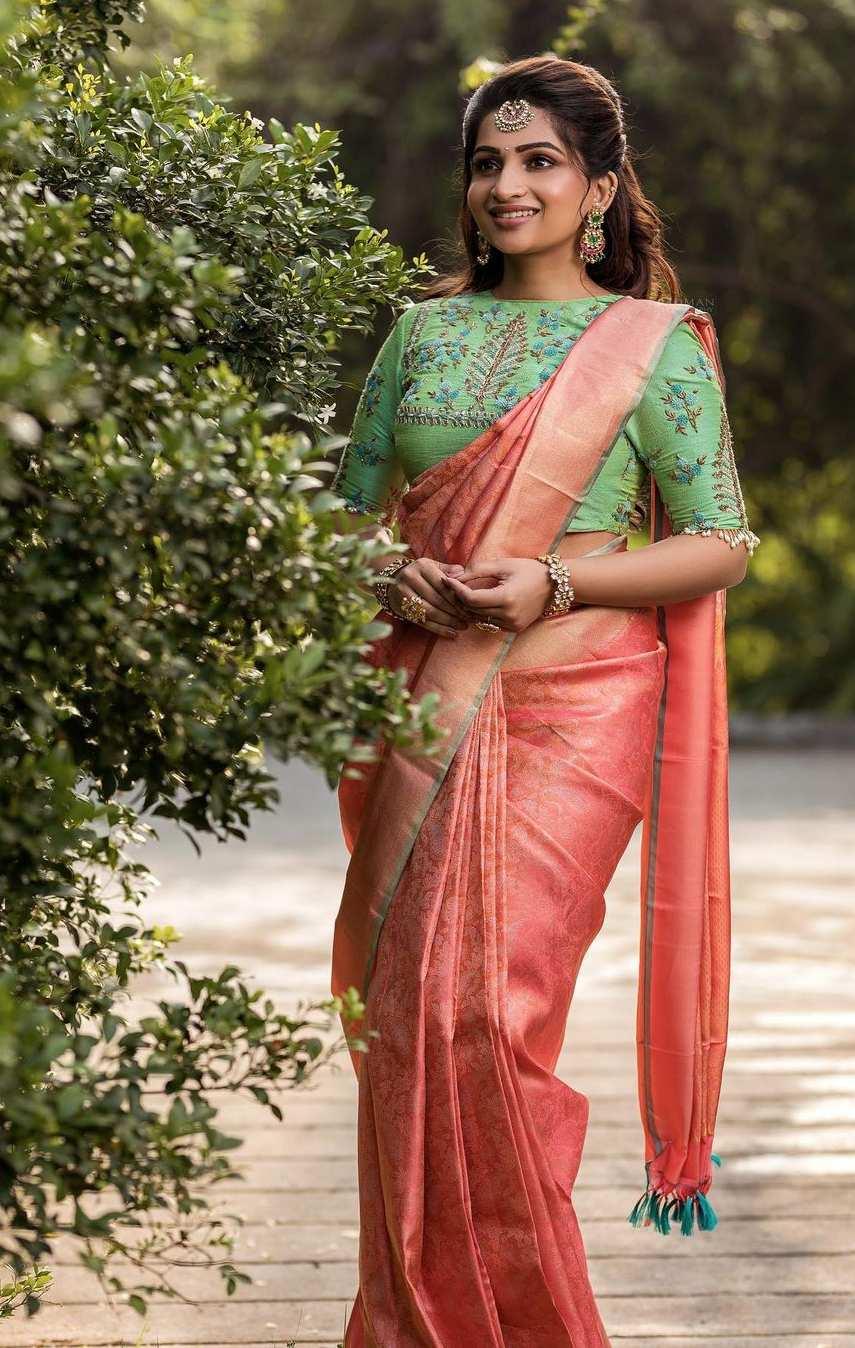 Nakshathra Nagesh in peach pattu saree by sadhan