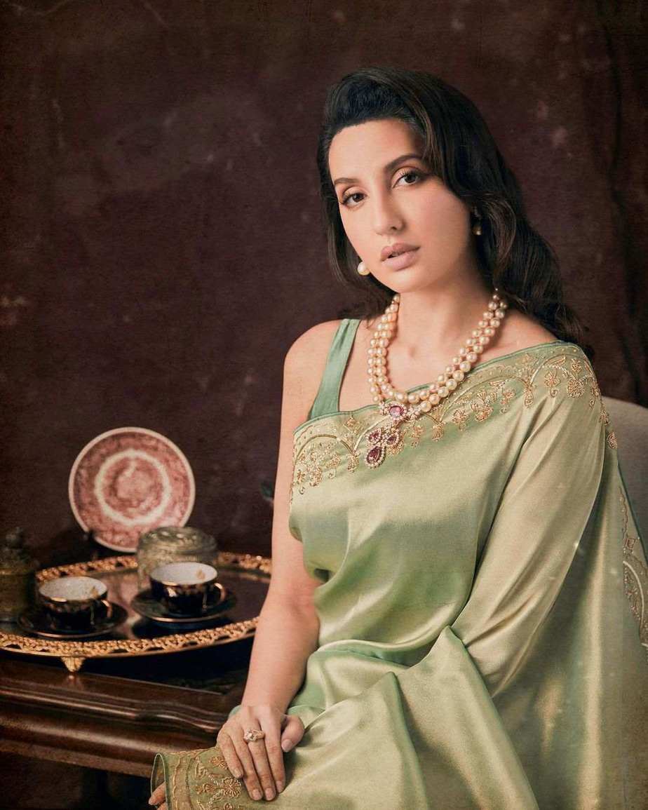 Nora Fatehi in pista saree by Rukhmani for dadasaheb phalke-21