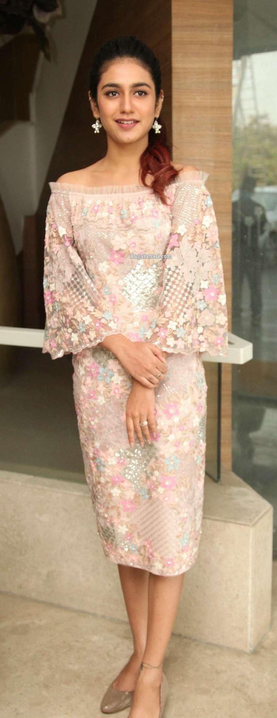 Priya Prakash Varrier in peach dress for check press meet1
