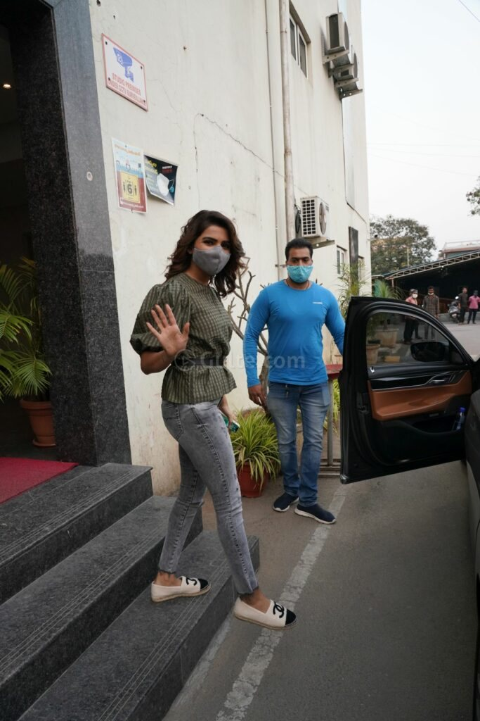 Samantha after an ad shoot in ganni top and grey denim