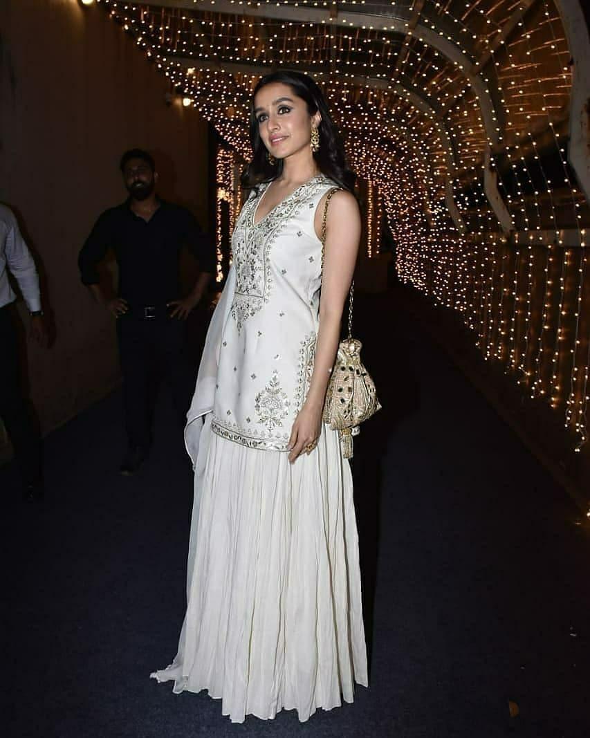 Shraddha Kapoor in ivory lehenga set by Anita Dongre fro cousin's wedding3