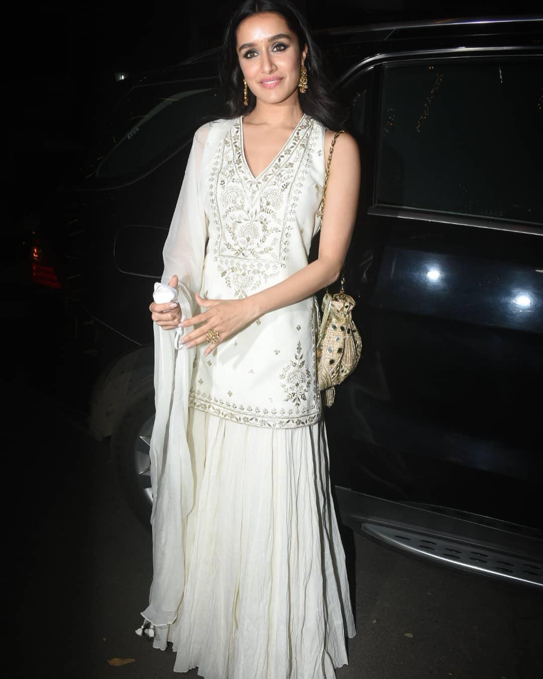 Shraddha Kapoor in ivory lehenga set by Anita Dongre fro cousin's wedding7.1