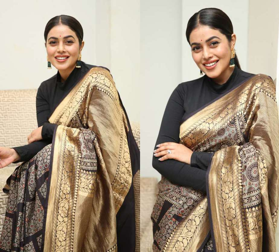 actress poorna in a black and gold silk saree at sundari trailer launch