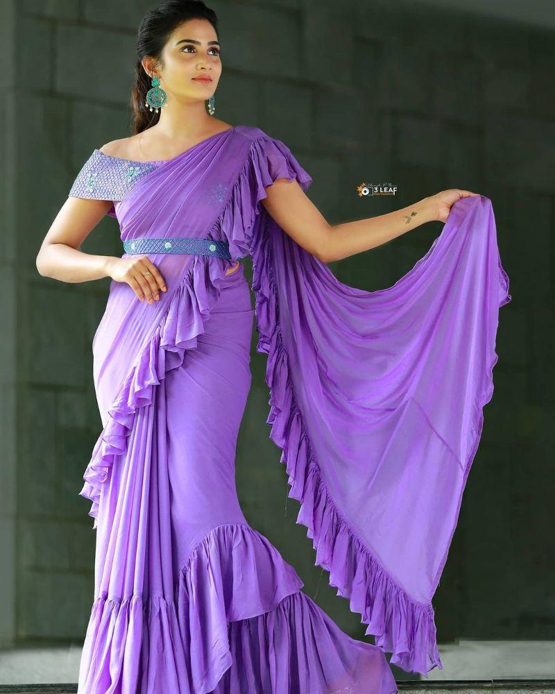 aditi ravi in a light purple ruffled saree with belt