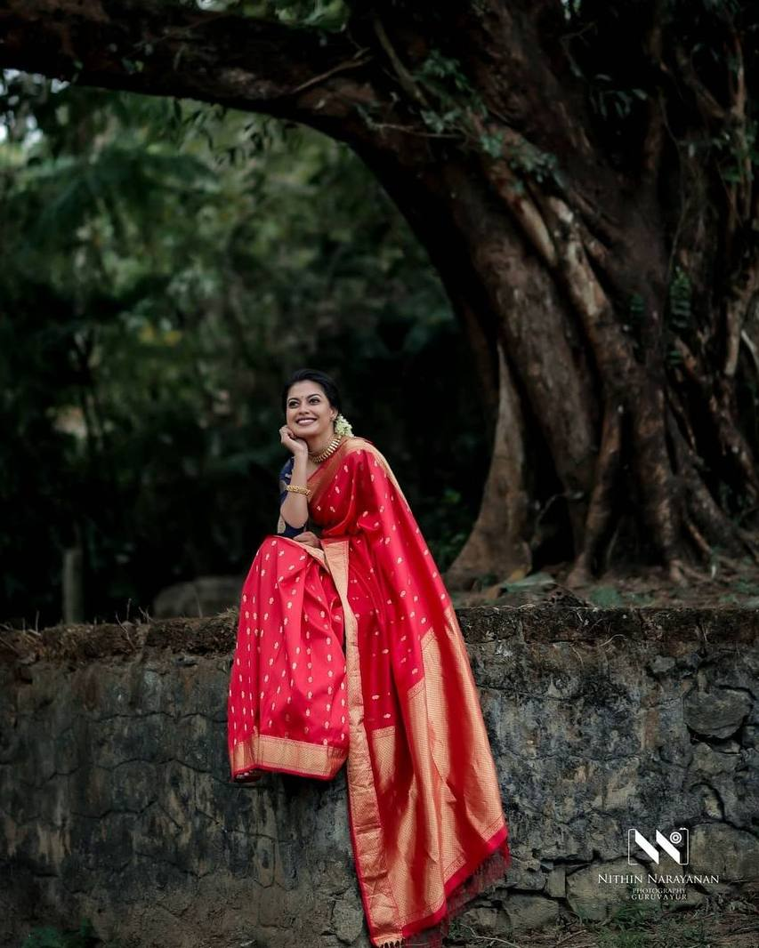 anusree in a red pattu saree2
