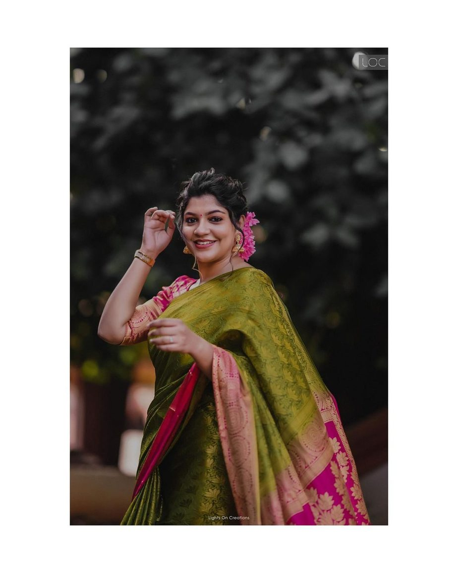 aparna Balamurali in olive green pattu saree by Margazhi designs for friend's wedding-1