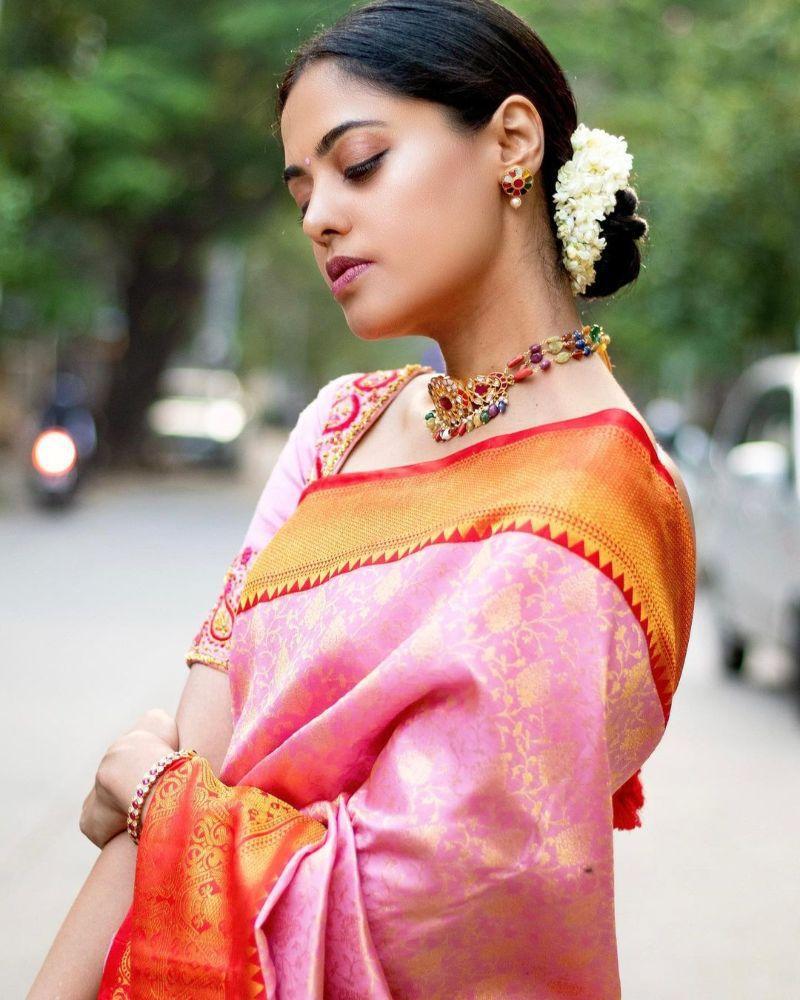 bindu madhavi at a friend's wedding in a pink silk saree