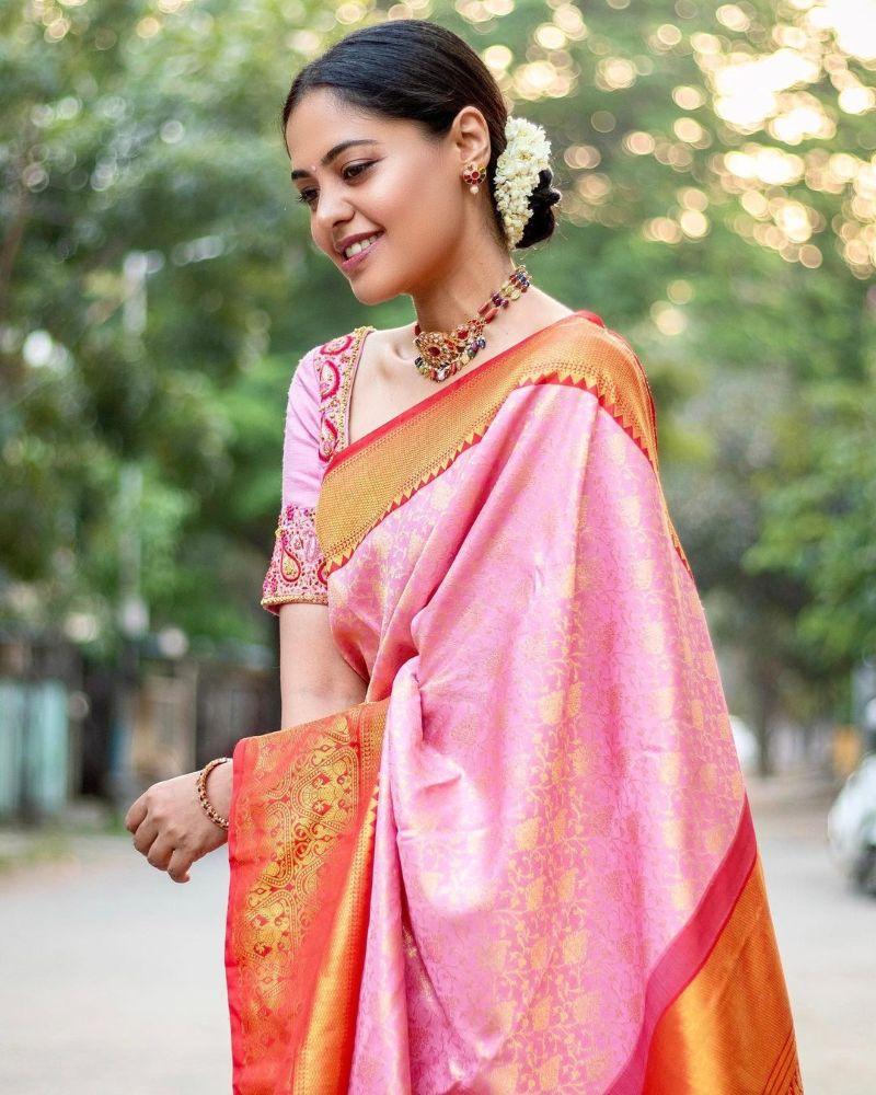 bindu madhavi in a pink silk saree with red borders