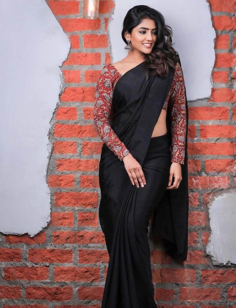 eesha rebba in a black saree red printed kalamkari full sleeve blouse