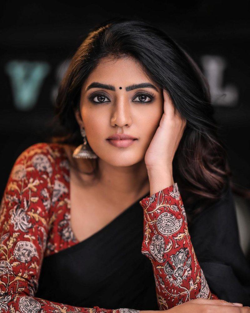 eesha rebba in a full sleeve kalamakari blouse and black saree