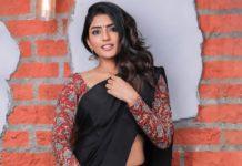 eesha rebba in black saree and red kalamkari blouse