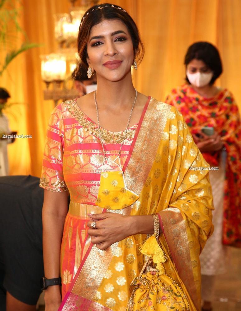 lakshmi manchu in a long anarkali with yellow mask