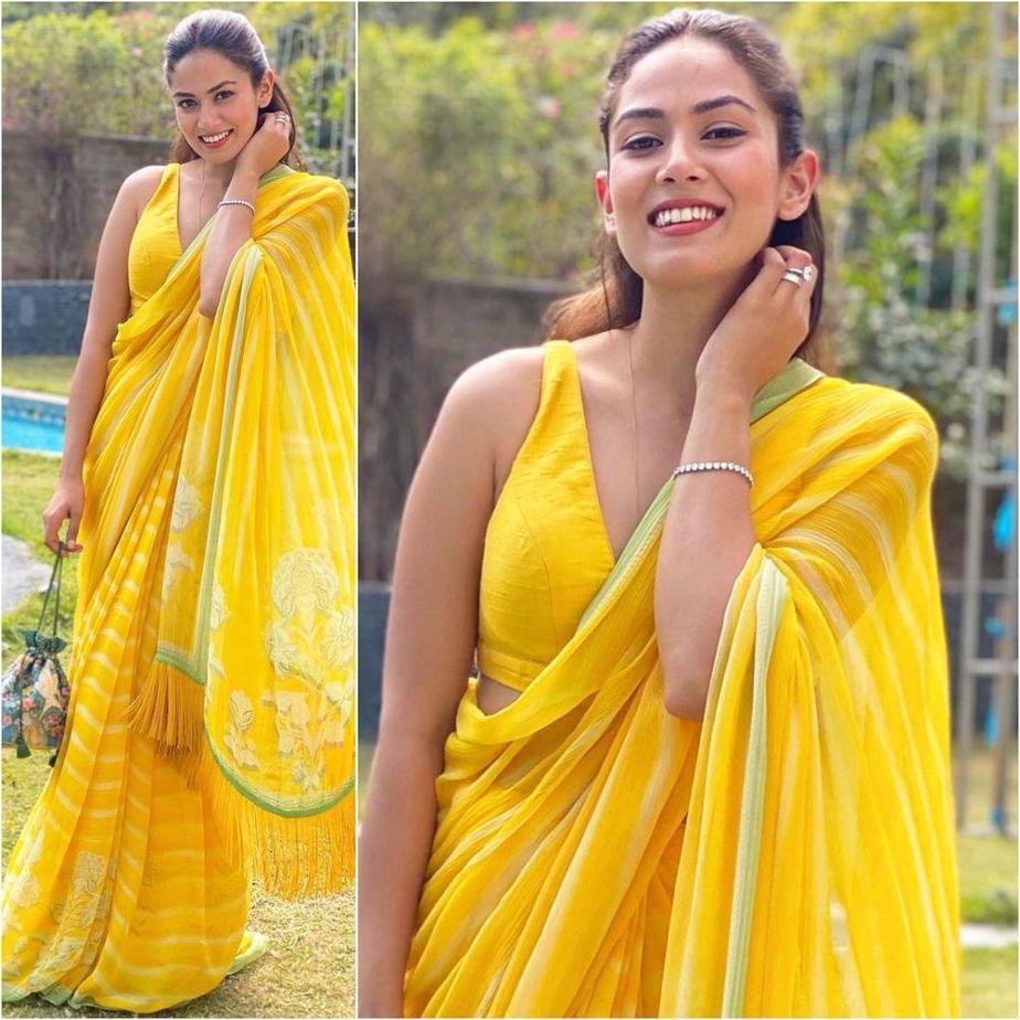 mira rajput in a yellow silk saree at friend's wedding