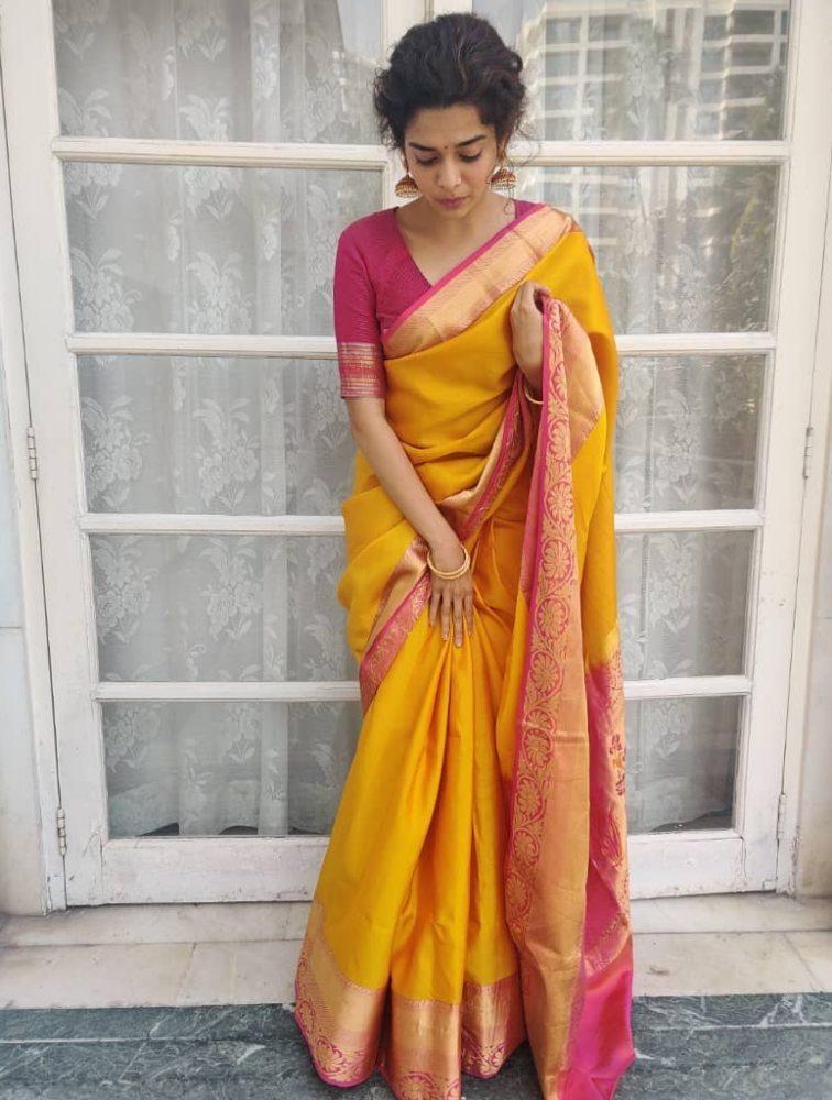 mithila palkar in yellow silk saree with pink gold border