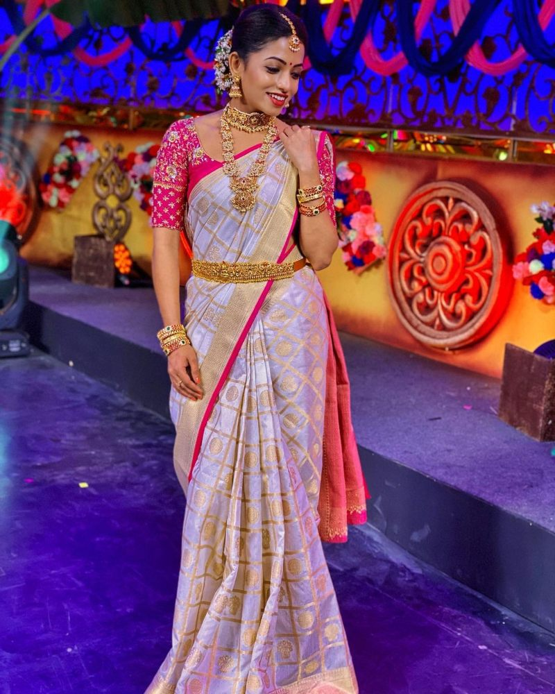navya swamy in gold and pink silk saree