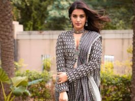 nidhhi agerwal in black and white drape skirt and jacket