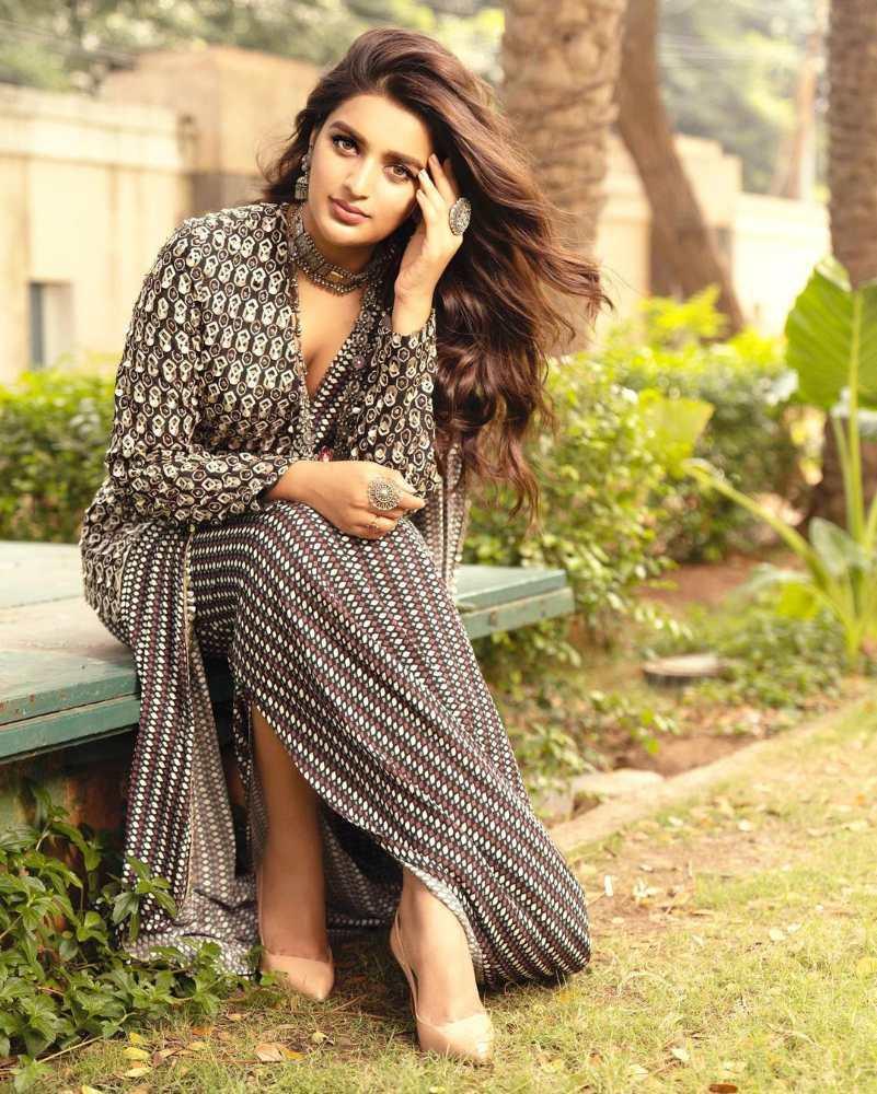 nidhi agerwal black and white jacket saree