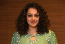 nithya menen in a long green kurta