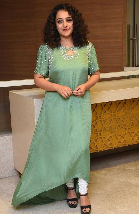 nithya menen in long green kurta at ninnila ninnila press event